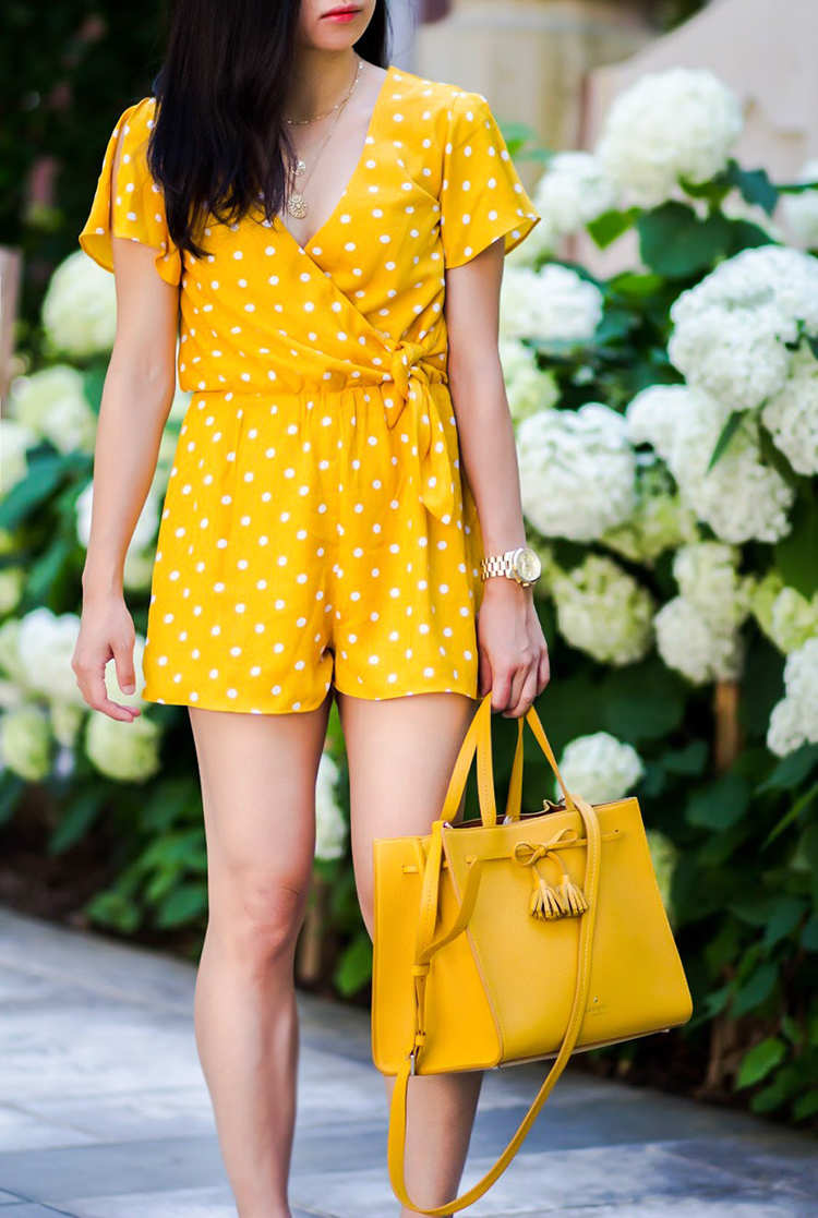 bac04354cc86 There are few things I enjoy wearing in the summer more than brightly  colored one-pieces. This Everly Surplice Romper–with its cheerful color