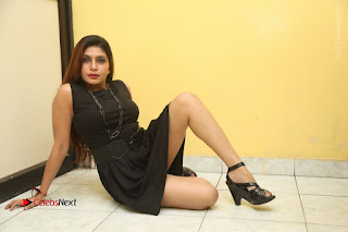 Tollywood Upcoming Actress Pooja Roshan Stills in Black Short Dress at Plus 1 Movie Trailer Launch  0379.JPG