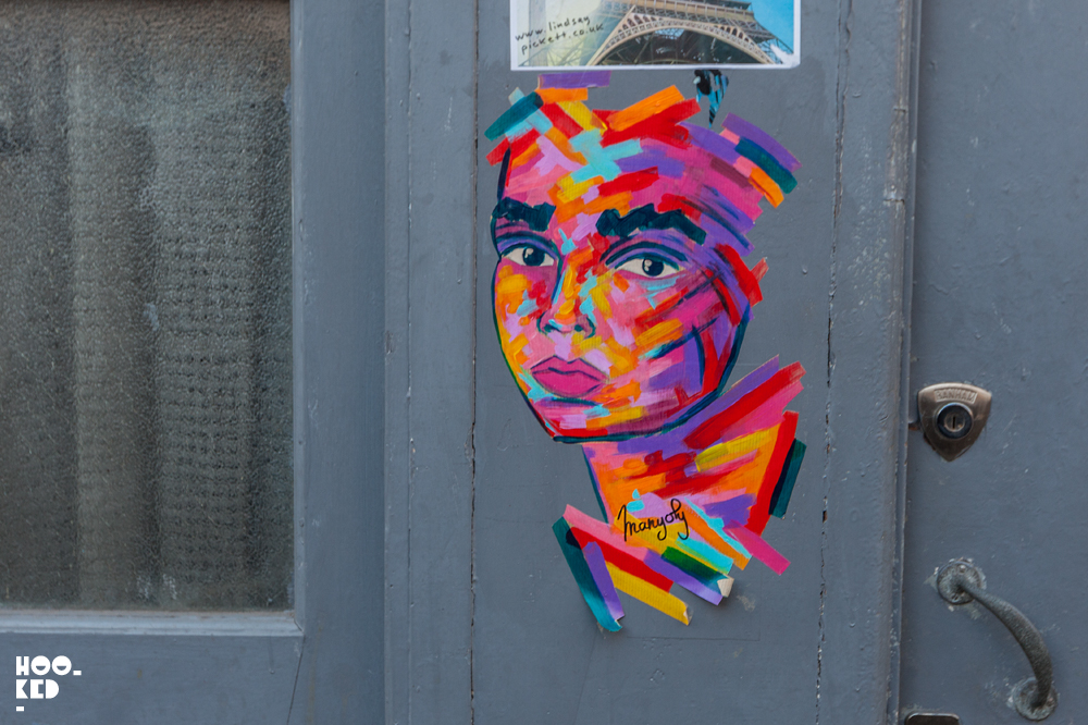 Vibrant portrait pasteups by French street artist Manyoly