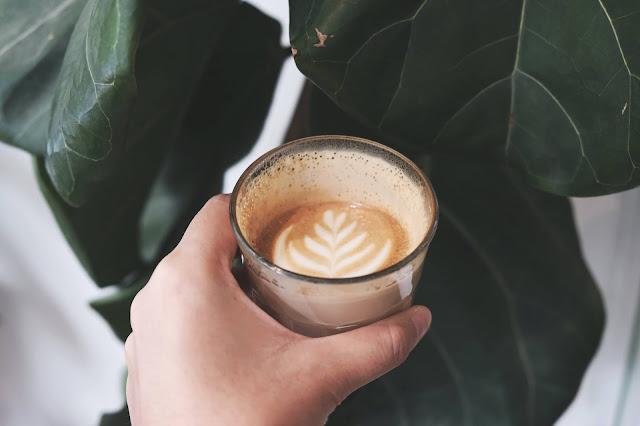 half a cup of coffee.Photo by Lex Sirikiat on Unsplash