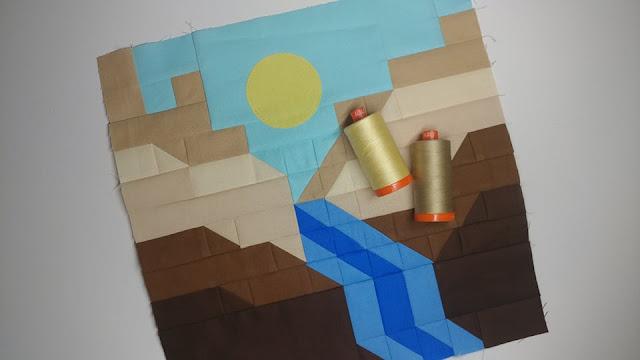 Aurifil thread and canyon quilt block