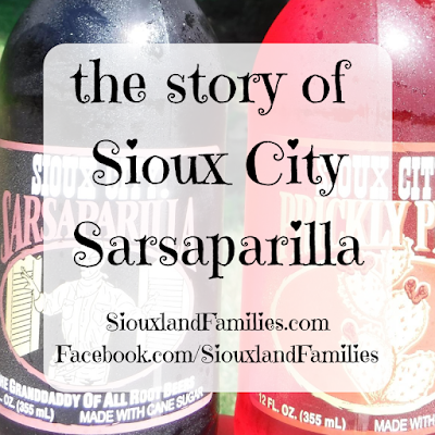"""in background, a close shot of a bottle each of dark brown Sioux City Sarasparilla and fuschia Sioux City Prickly Pear soda. in foreground """"the story of Sioux City Sarsaparilla"""" and """"SiouxlandFamilies.com Facebook.com/SiouxlandFamilies"""