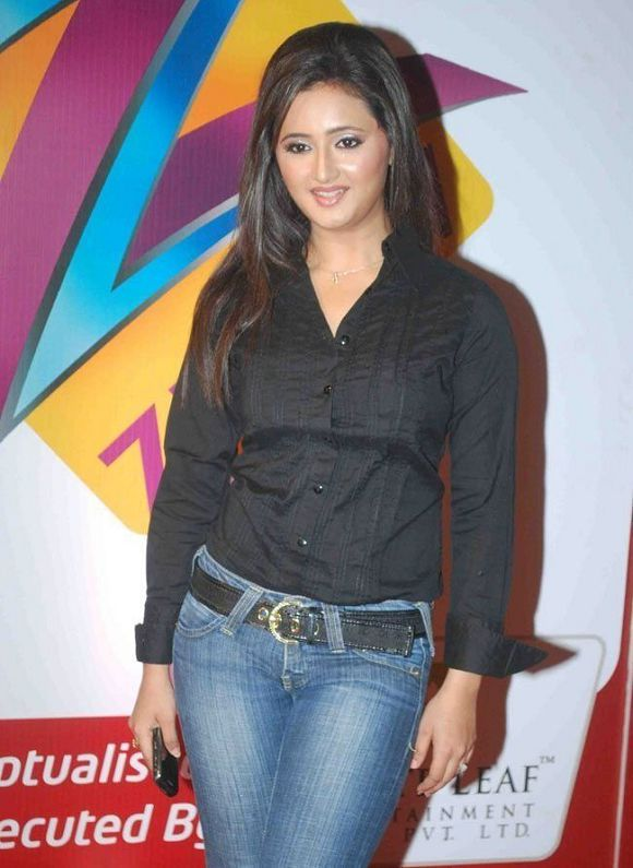 Rashami Desai IN TIGHT OUTFIT exposing cleavage  BLUE JEANS