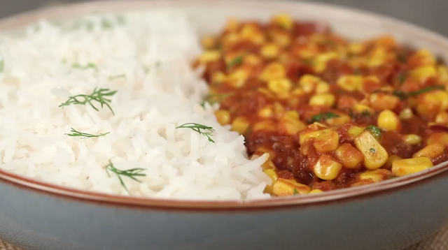 Delicious corn curry with steamed rice
