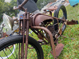 Rusty motorcycle with heavily rusted gas tank.