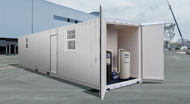The MAC Portable Toilet System in a ground-level shipping container
