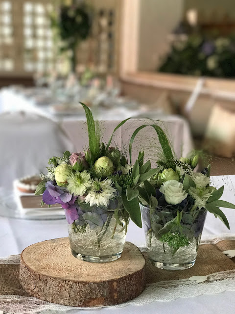 Flower centerpieces, Table decor with Hessians, wood, grey, brown, green, lilac, Wedding abroad, Mountain wedding lake-side at the Riessersee Hotel Resort Bavaria, Germany, Garmisch-Partenkirchen