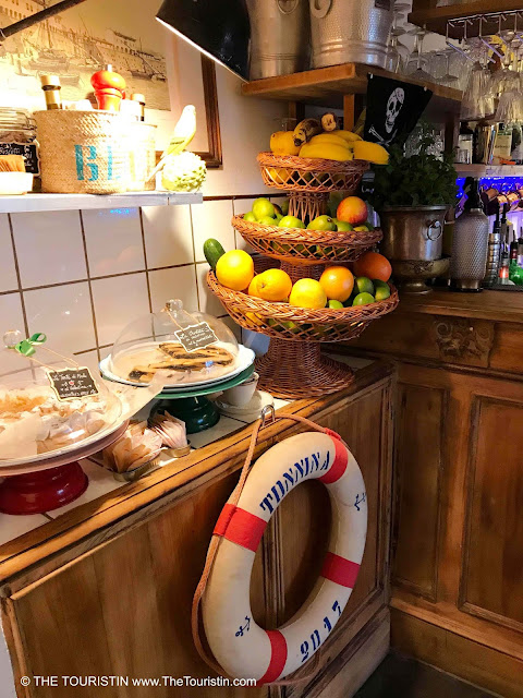 Biscuits and fruit on a counter decorated with a lifebuoy.