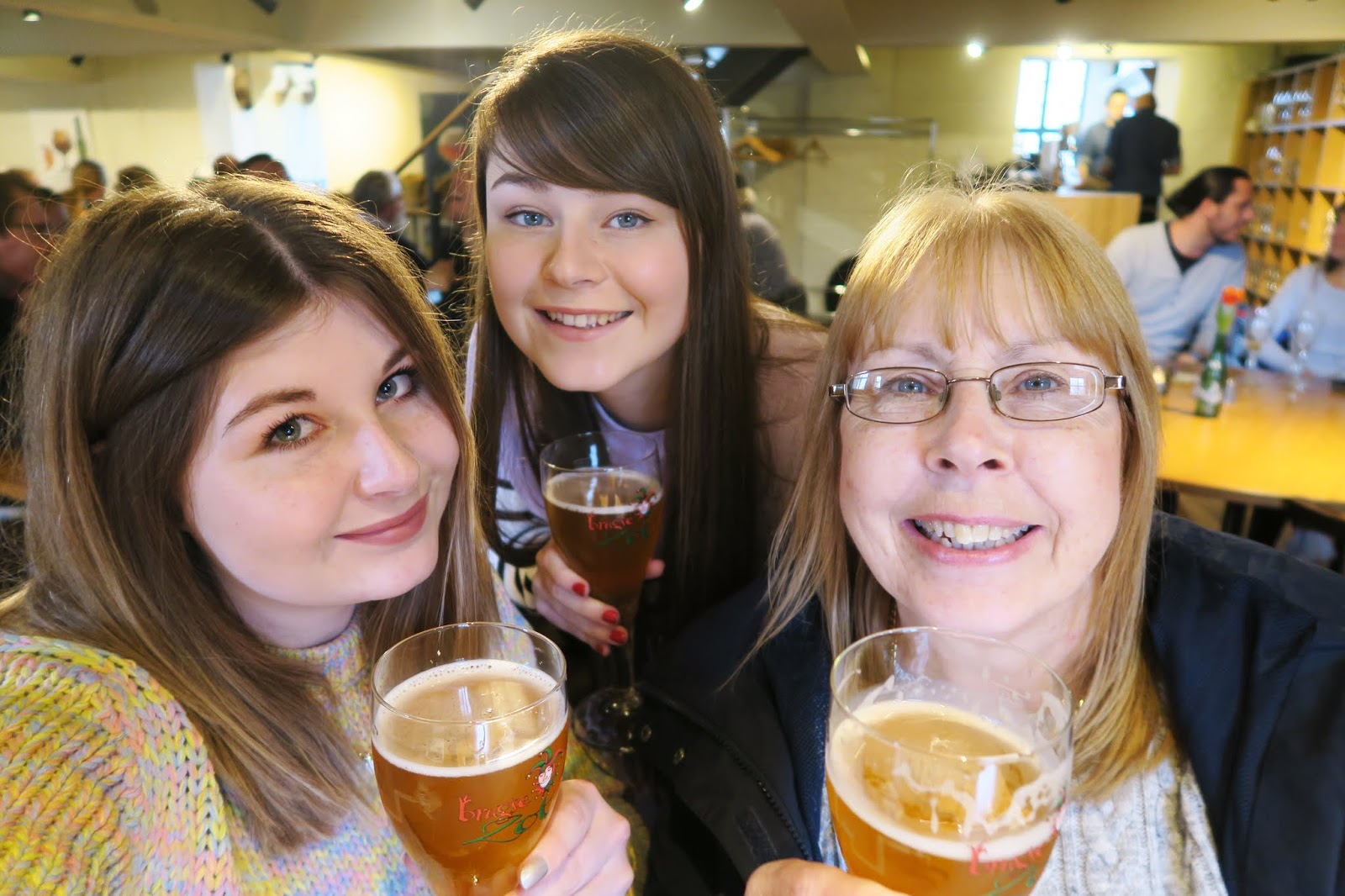 Myself and my family toasting with our beers inside De Halve Mann Brewery Bruges