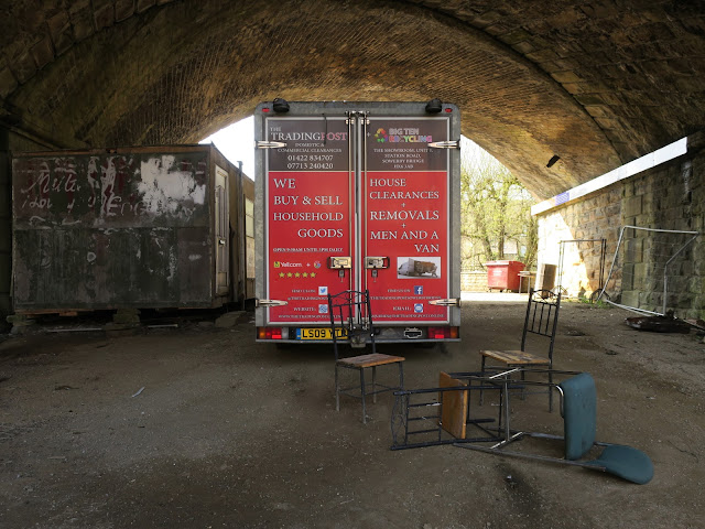 Removal lorry with red back under arch of bridge. 17th April 2021