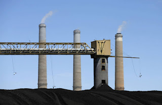 Coal piles sit outside a PacifiCorp power plant near Castle Dale, Utah. The plan rejected by regulators would have paid utilities extra to keep stockpiles of coal on hand. (Credit: George Frey/Getty Images) Click to Enlarge.