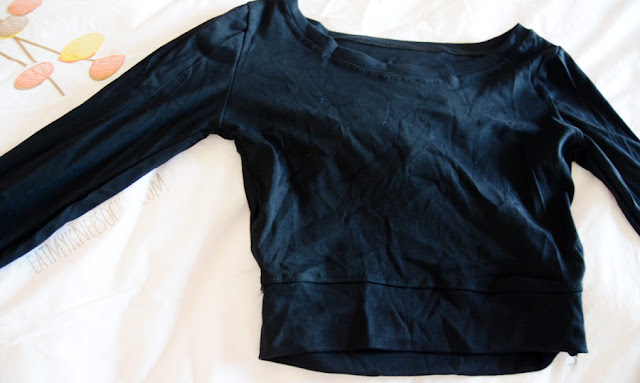 Black long sleeve cutout back boat neck crop top with thumbholes from SheIn.