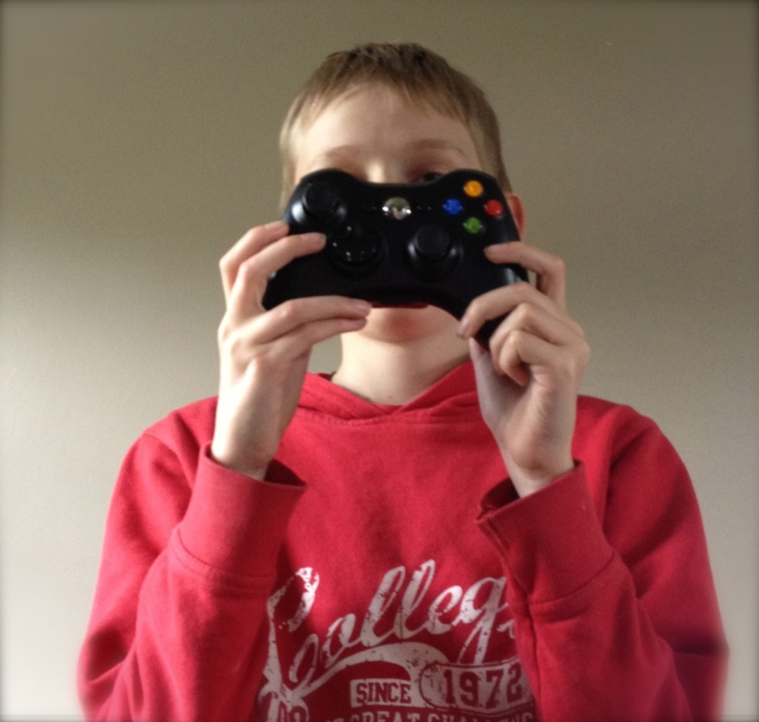teen with X-box controller