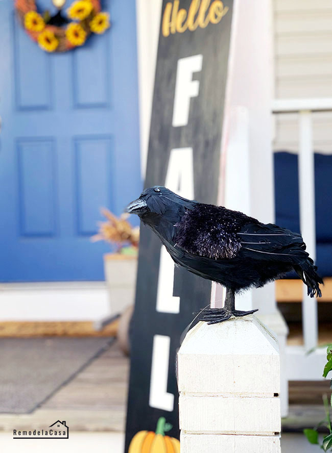 Black crow on railing - Halloween decor