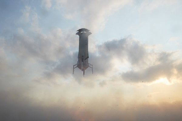 The New Shepard booster is about to touch down at Blue Origin's Launch Site One outside Van Horn, Texas...on July 20, 2021.