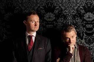 Mark Gatiss and Martin Freeman as Mycroft Holmes and John Watson in BBC Sherlock