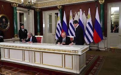Vladimir Putin and Tabare Vazquez.