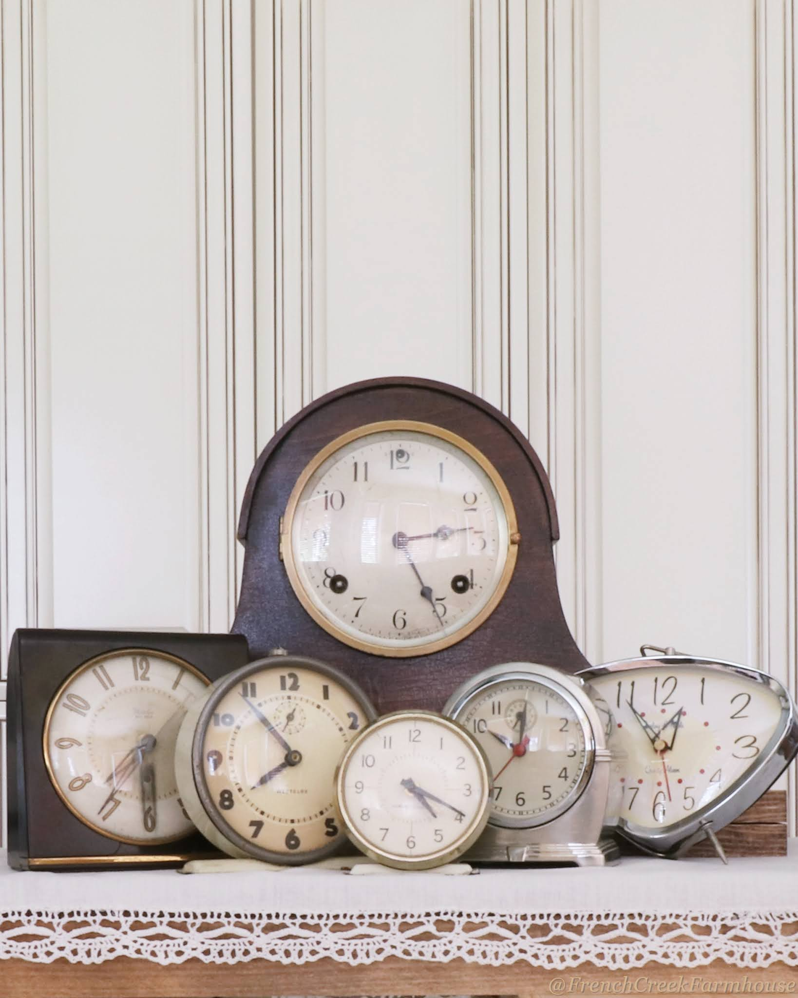 A collection of vintage clocks will make a statement in your neutral decor