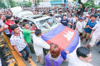 Supporters draped Kem Ley's car in flowers and Cambodian flags as it moved up Monivong Boulevard yesterday. KT/ Chor Sokunthea