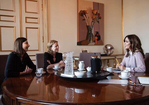 DRC's new secretary general Charlotte Slente and DRC's Chair Agi Csonka. silk shirt women white contrast collar lila blouse. diamon rings