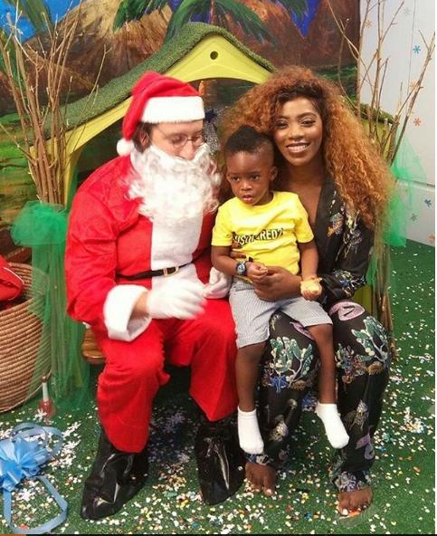 Photos: Tiwa Savage and Jamil pose with Santa