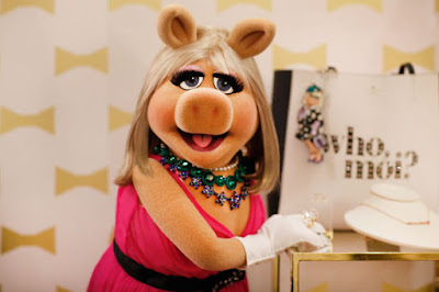 Miss Piggy with Catherine Baba and Jourdan Dunn in the Kate Spade holiday campaign. Photo: Courtesy