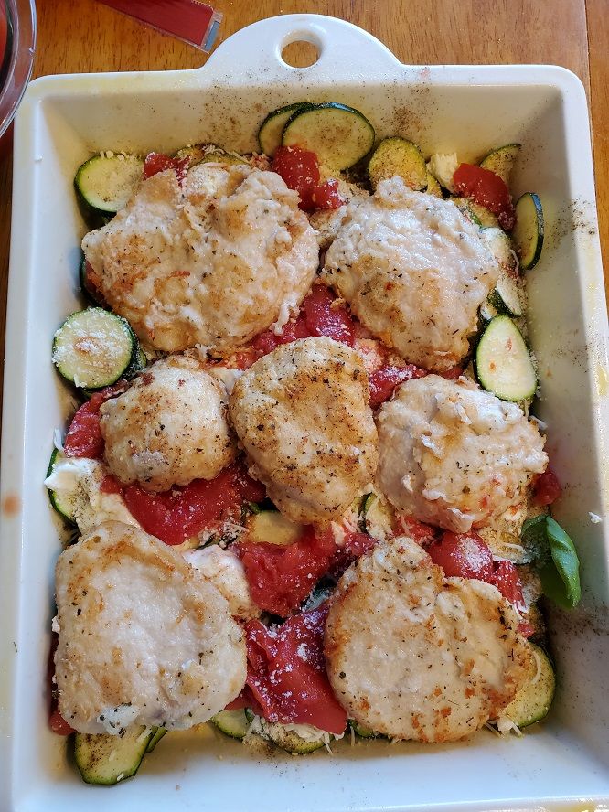 this is baked chicken with ricotta, tomato, cheeses and zucchini