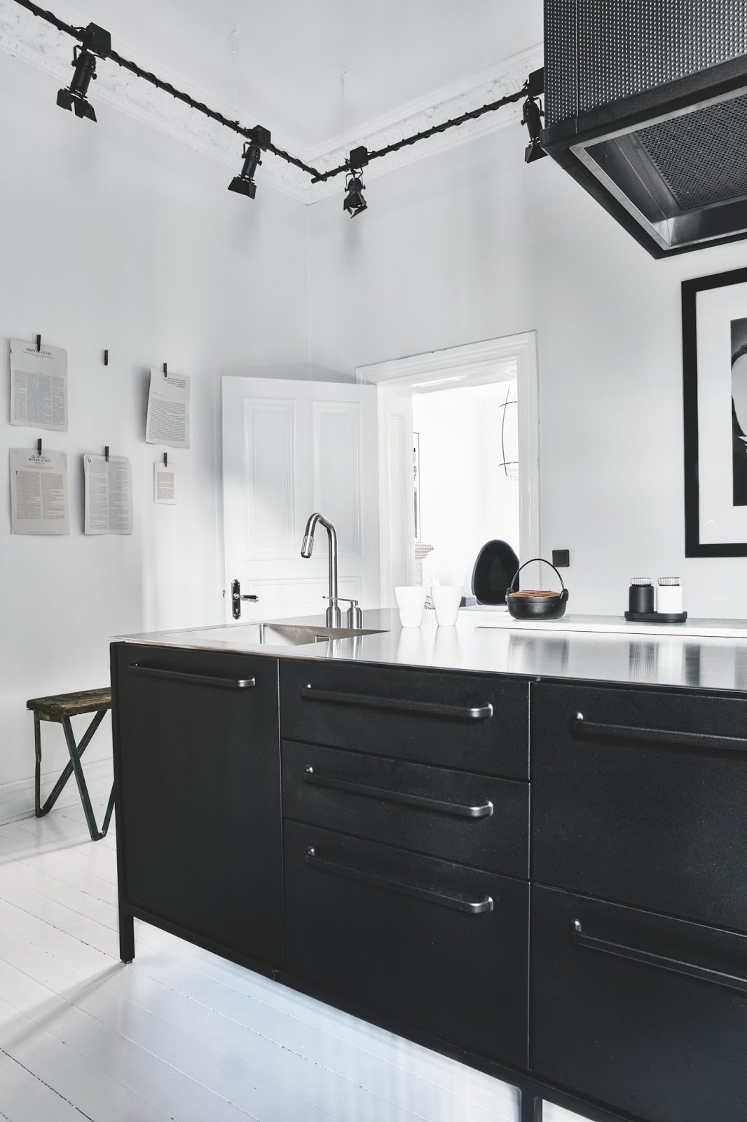 amazing black kitchen with a white painted floors