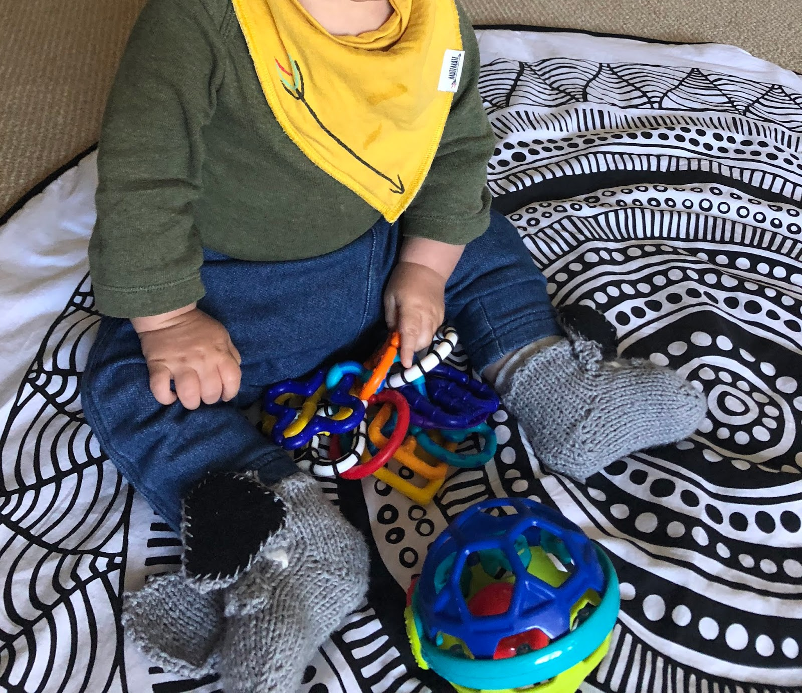 db69ac25f4c ... top and pants with hand made booties (they are little elephants -  thanks Lolly!) and preloved toys on his organic cotton playmat