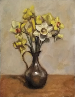 Oil painting of a variety of daffodils in a pewter jug.