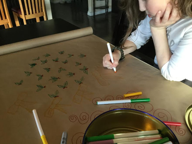 Decorating plain brown paper with markers