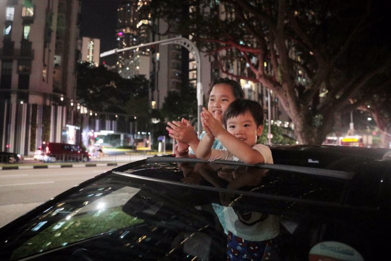 Siblings Lucas Low, four; and Hayley Low, eight; clapping in appreciation of Covid-19 frontline workers, at Cantonment Road on March 30, 2020.