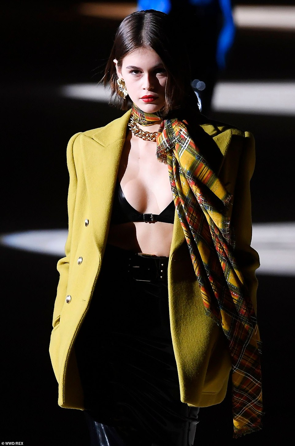 Kaia Gerber puts on a busty display in latex bra at the Saint Laurent Paris Fashion Week Show