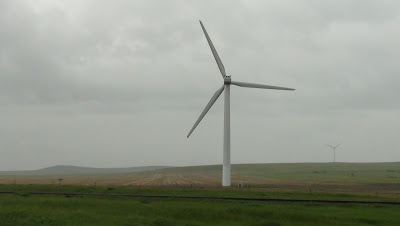 Giant windmill turbine on farm field