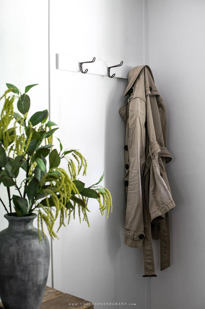 Coat hanging on vintage hooks