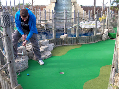 Playing at the Lost World Adventure Golf in Hemsby, Norfolk