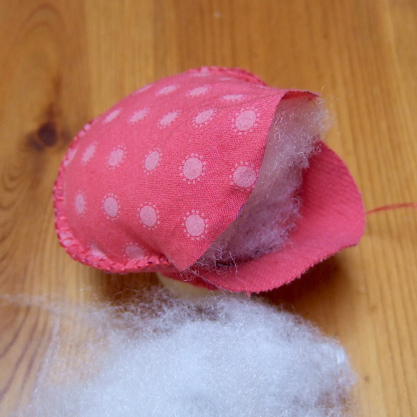 Stuffing the red spotted dotty dots fabric felt plushie pincushion