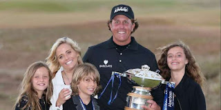 Phil, his wife Amy, and their children celebrate his win
