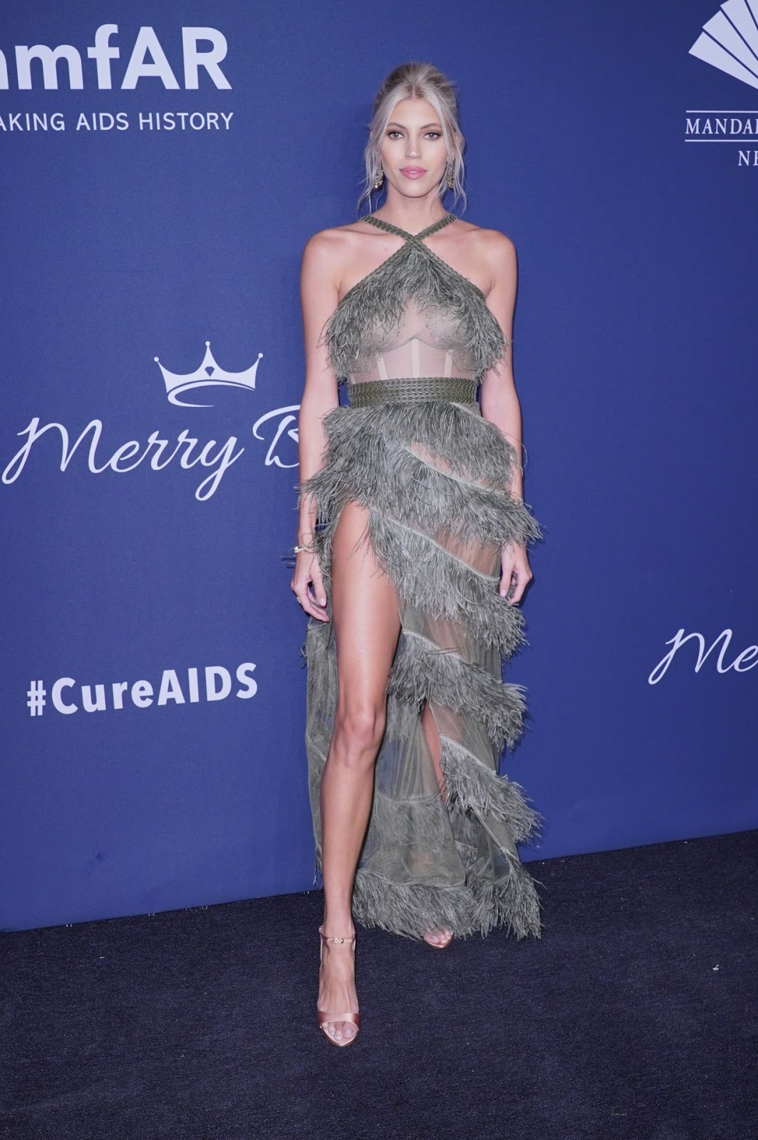 Devon Windsor arrives in sheer feathered gown to the amfAR 2020 New York Gala