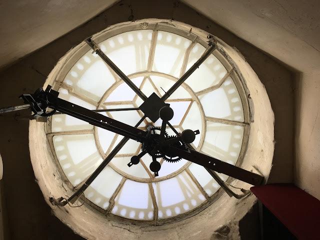 Sitting behind Bath Abbey clock tower - Bath staycation