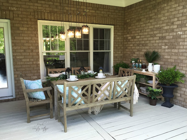 Wood bench at outdoor dining table area