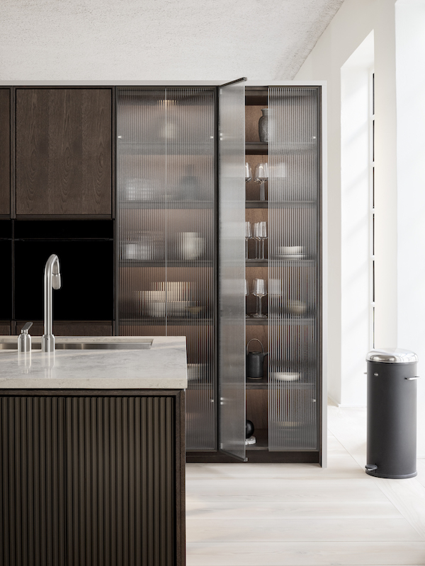 A new kitchen by VIPP in dark oak and jura marble