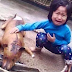 Watch: Powerful photo of a 5-year-old mourns the death of her dog after it was roasted for consumption