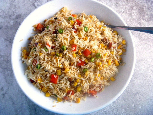 Beth's Confetti Rice:  Spicy sweet bell pepper, tender peas, crisp sweet corn, and sweet onion are combined with the heavenly rice and sprinkled with cilantro for extra flavor.  Amazing!  This is the PERFECT rice to serve with any grilled meat.  Slice of Southern