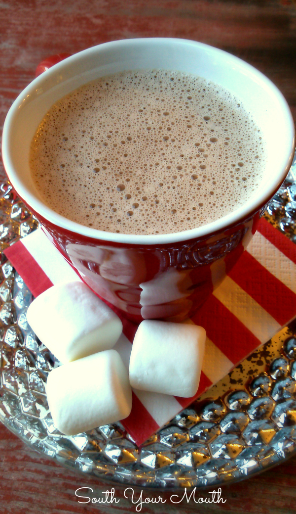 Crock Pot Hot Cocoa! Make hot chocolate for a crowd with this simple homemade recipe for Hot Cocoa that heats and keeps warm in a crock pot or slow cooker.