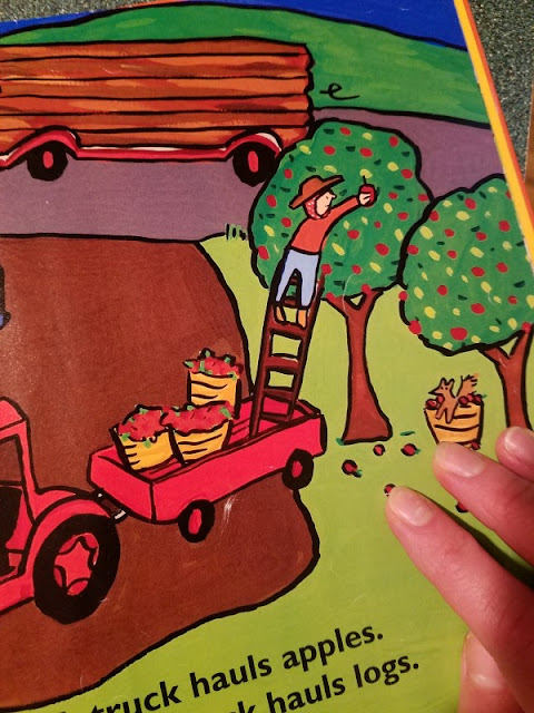 illustration of a person picking apples from a ladder inside a truck's trailer - 7 Quick Takes about Cruel Ironies, Precarious Ways to Harvest Your Fruit, and Corny Jokes from a Word Nerd  {posted @ Unremarkable Files}