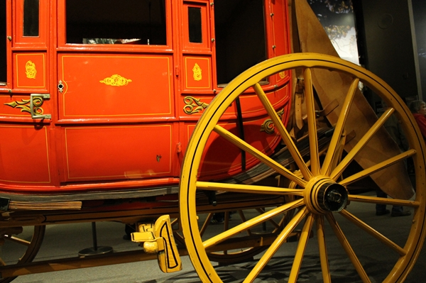 antique red carriage with yellow wheels