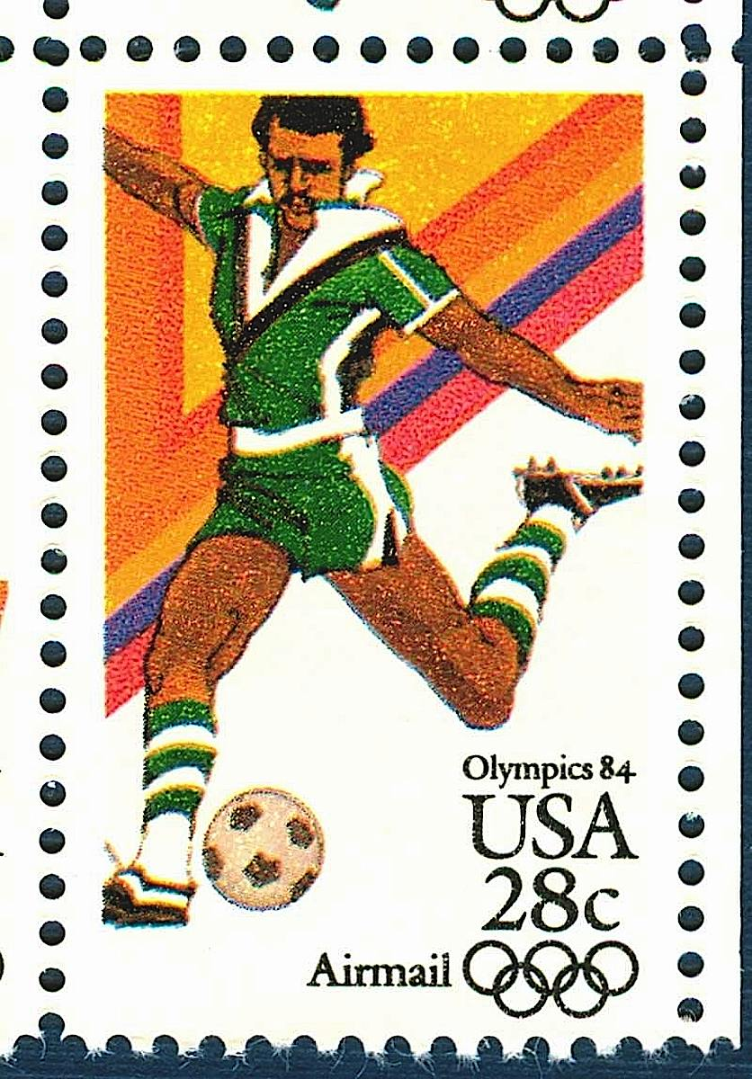 a Bob Peak illustrated USA postage stamp, Olympics 84 28c Airmail, a soccer player kicking the ball