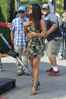 Priyanka Chopra looks super cute in happy mood wearing a short flower print dress in Hollywood 013.jpg