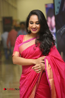 Actress Pooja Ramachandran Pictures in Red Silk Saree at Siddhartha Audio Release  0032.JPG